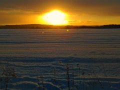 Zimowy_zachˇd_s│o˝ca_O._Pruske_Postomino.jpeg